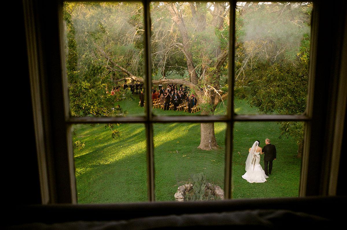 Bride walks down aisle with father. San Antonio Wedding Photographer