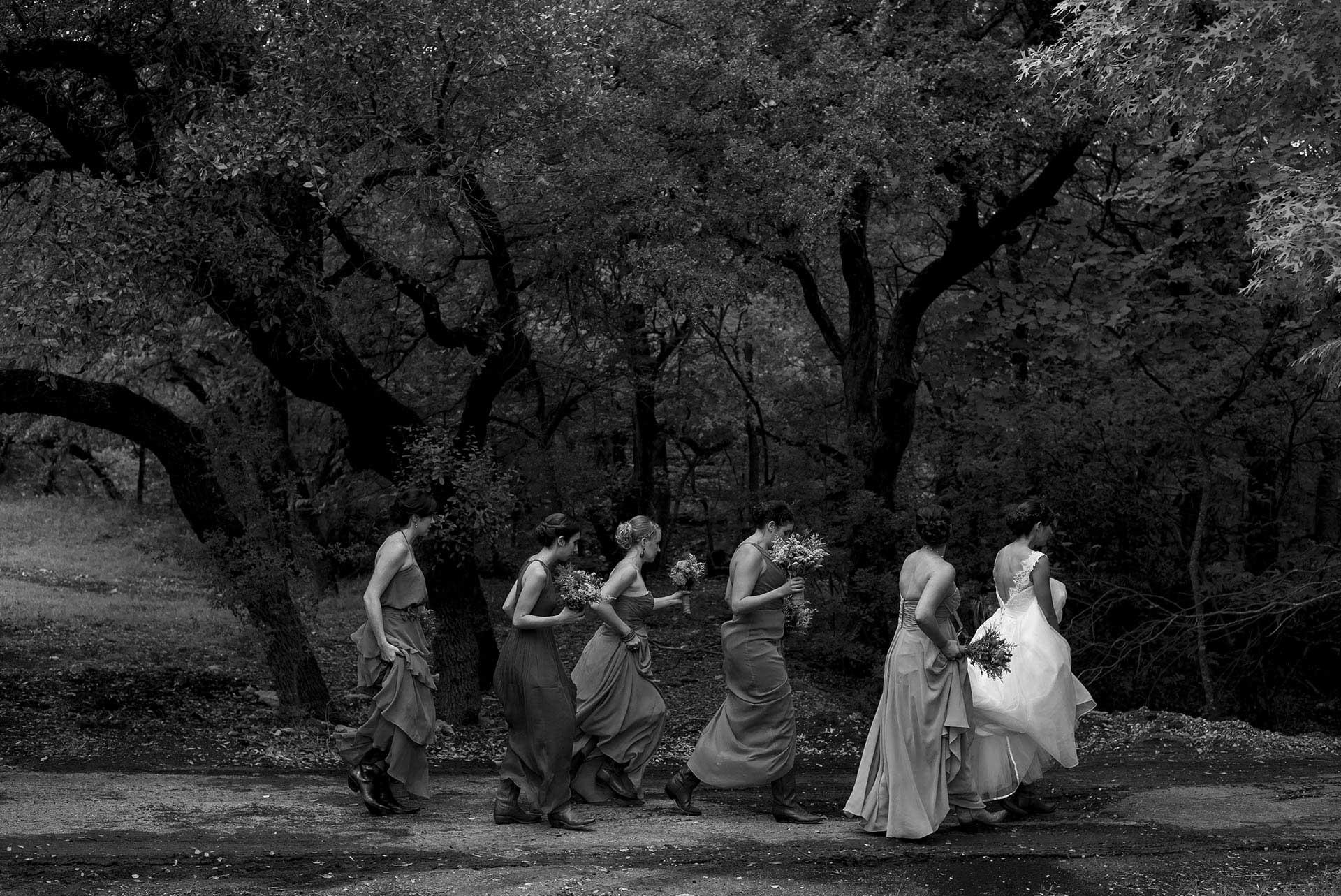Bridesmaids and bride walk to ceremony