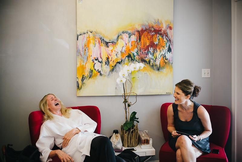 Bride shares a joke with bridesmaids at The Houstonian, Houston, Texas Wedding photographer Philip Thomas