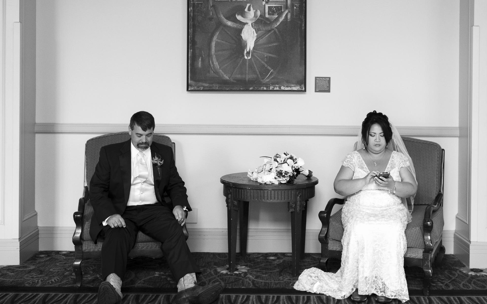 Bored couple just married sit apart at La Cantera Resort San Antonio Texas