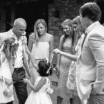 Humorous moments as flower girl pokes groom with flower