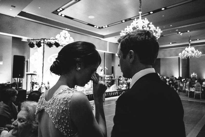 Bride wipes tear in emotional toast