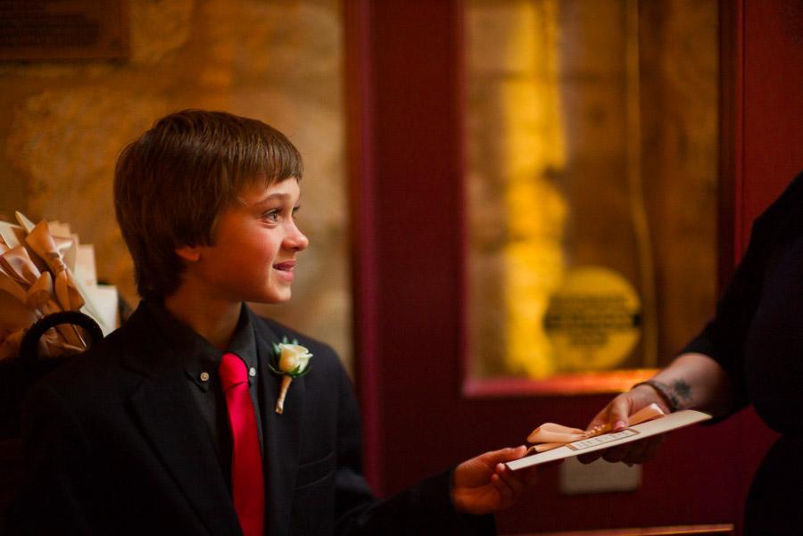 Boy handing out programs at La Villita