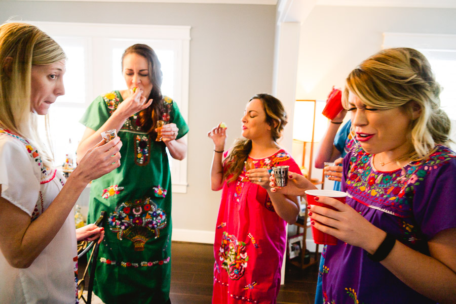 Bride and bridesmaids toasting a shot and reactions