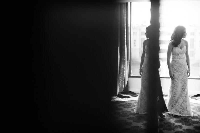 Bride walks her hotel room against mirror Omni Houston Hotel