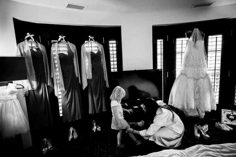 Bride dressing flower girl at The Valencia Hotel, San Antonio