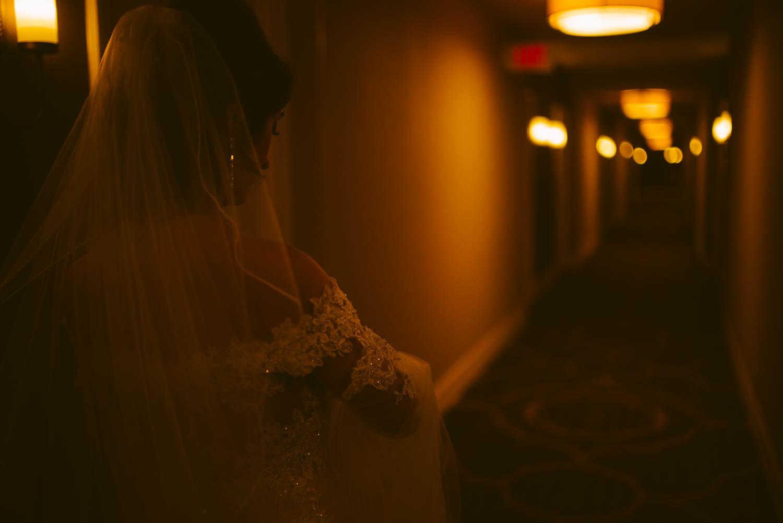 Bride leaves hotel room corridor on way to ceremony la-cantera-resort-wedding-photographer-philip-thomas