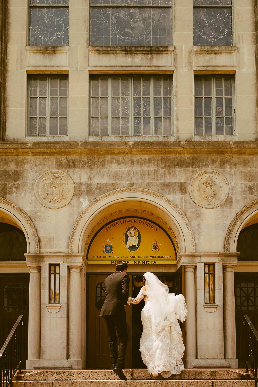 Couple arrive at Basilica of little flower up steps San Antonio Texas