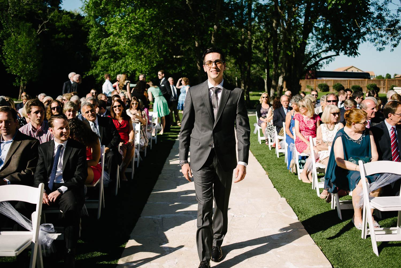 Groom walks down the aisle wedding Pecan Springs Houston Texas photo by Philip Thomas Photography