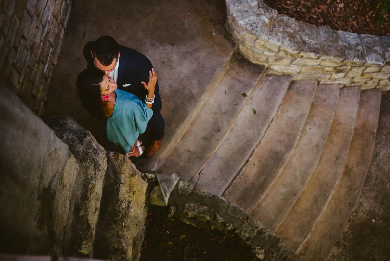 Couple in stairwell riverwalk Downtown San Antonio Engagement photos