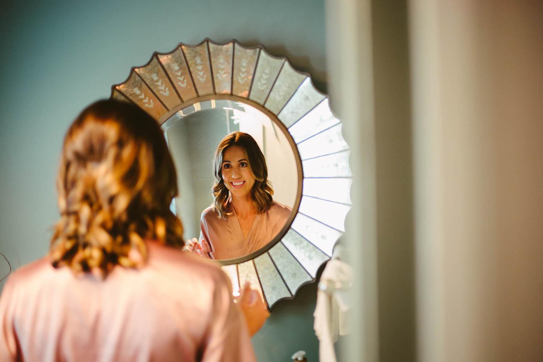 Bride checking mirror-Leica photographer-Philip Thomas Photography