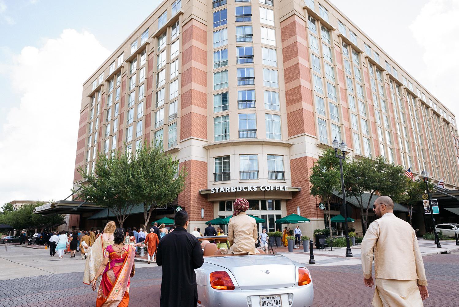 The Baraat with the Sugar Land Marriott in background Hindu Jewish fusion wedding Sugar Land Marriott Hotel Texas-041