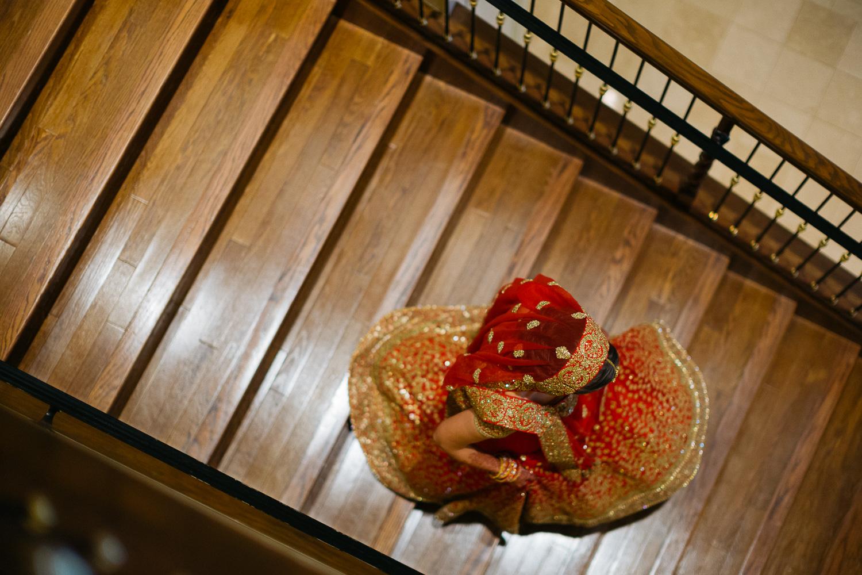 Bride descends staircase Hindu Jewish fusion wedding Sugar Land Marriott Hotel Texas-042