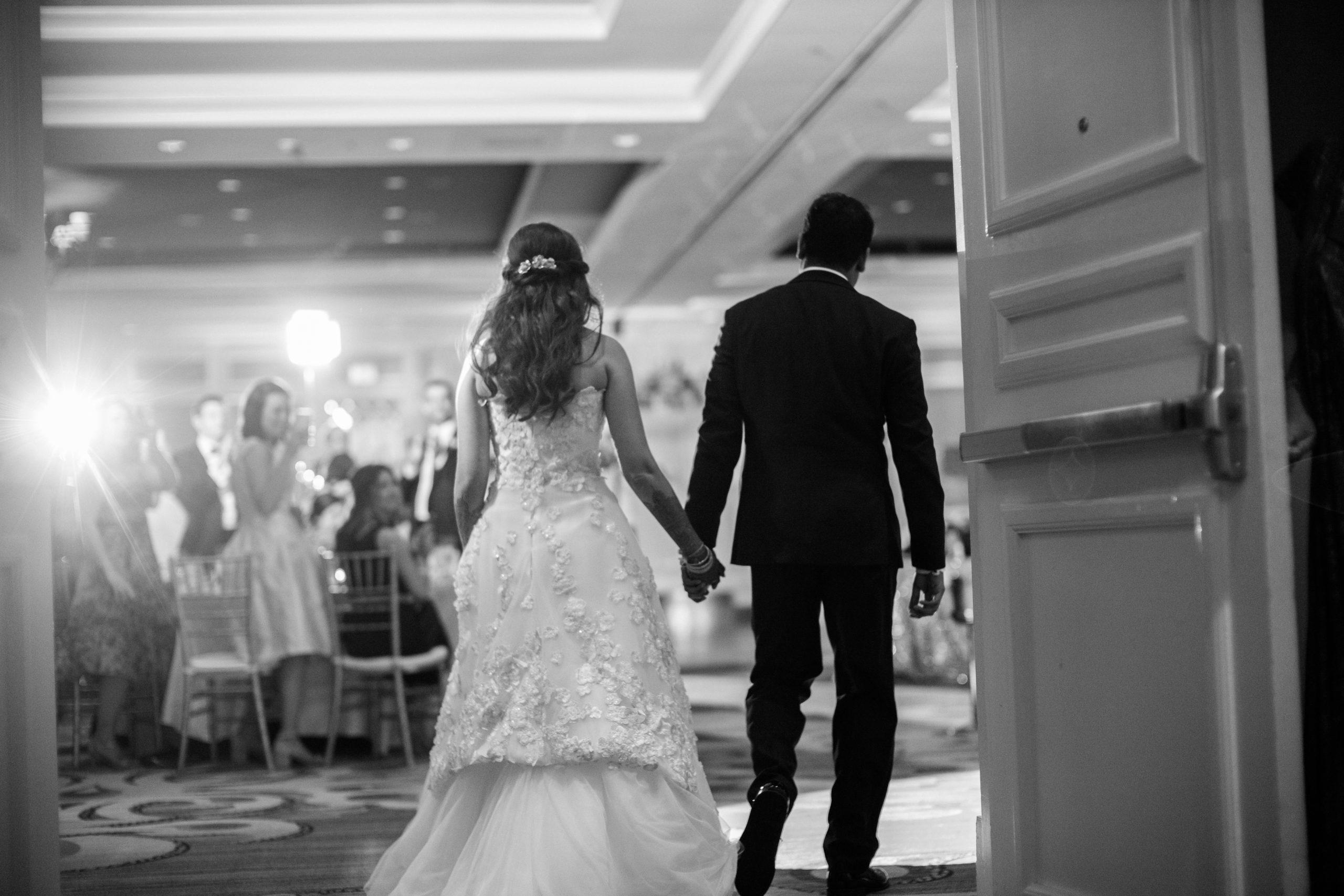 Couple reception entrance Hindu Jewish fusion wedding Sugar Land Marriott Hotel Texas-079