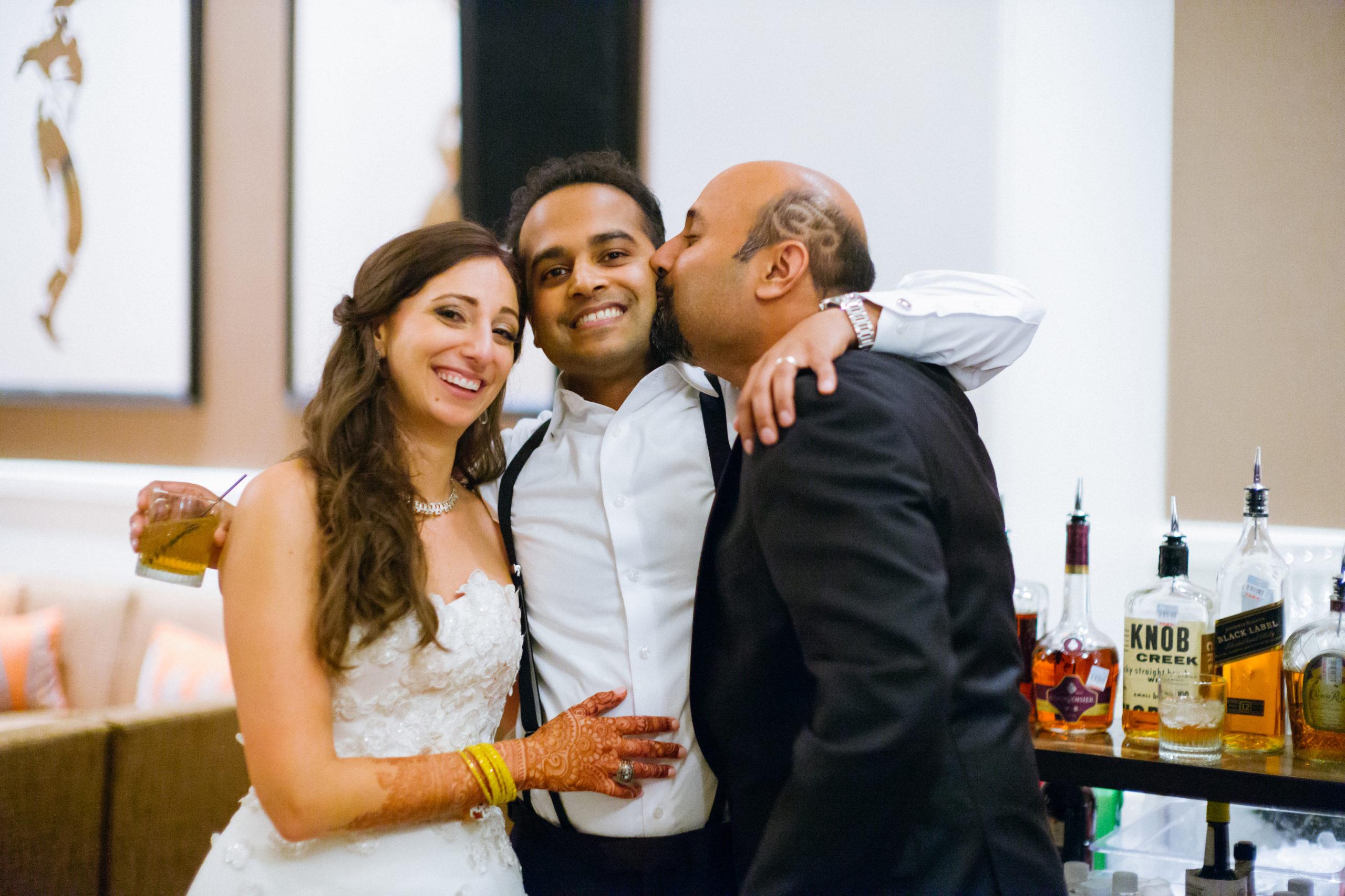 Friends gather in photo Hindu Jewish fusion wedding Sugar Land Marriott Hotel Texas-101