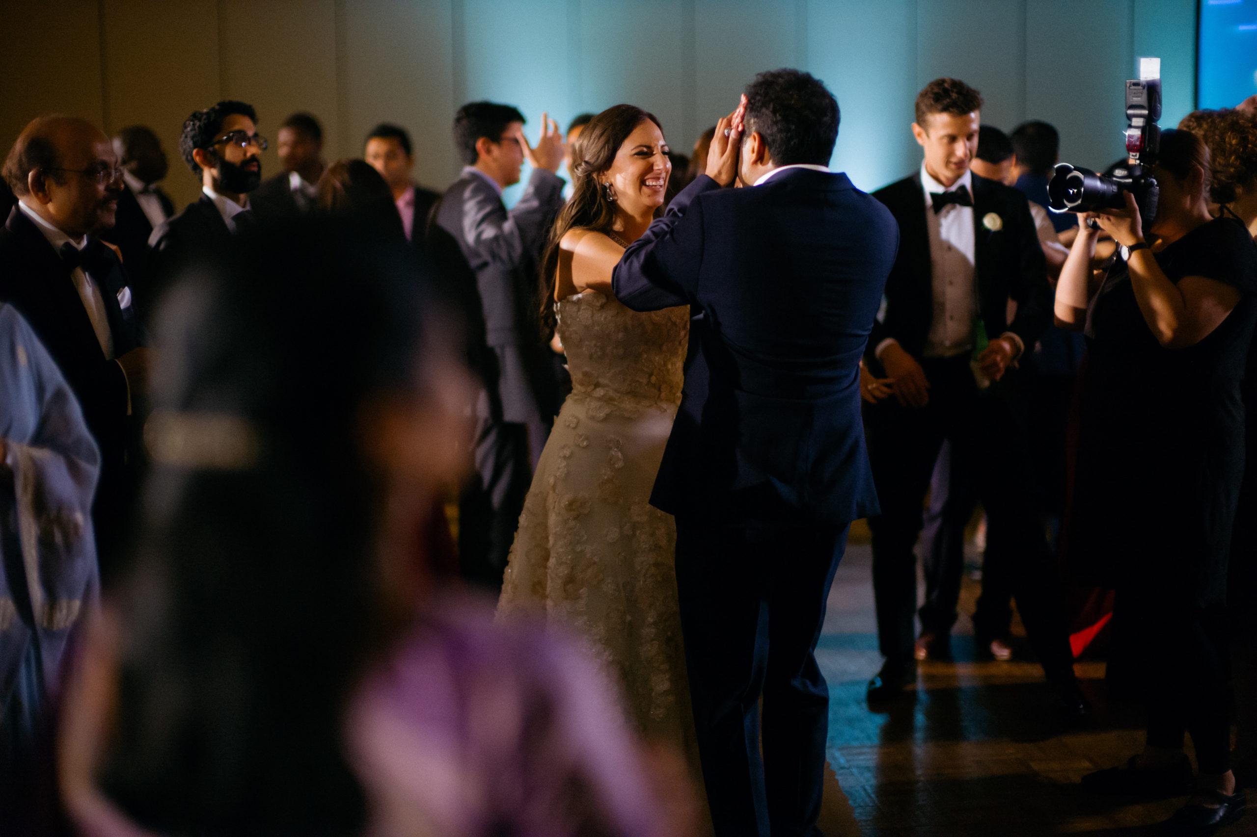 Bride covers grooms face Hindu Jewish fusion wedding Sugar Land Marriott Hotel Texas-102