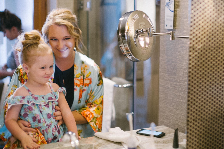 Mother and daughter flower girl in mirror JW Marriott Austin Wedding Photos-Philip Thomas