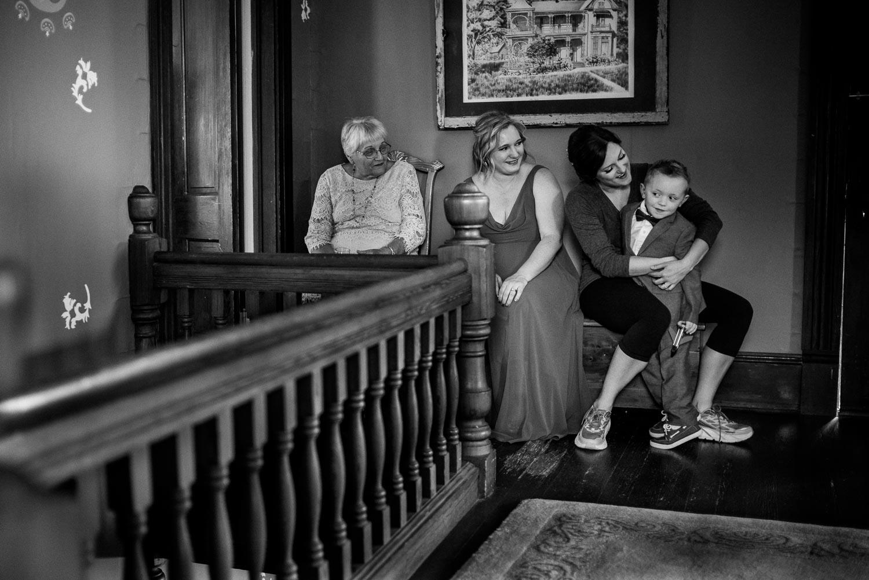 A little boy cuddles with the bride at Barr Mansion Austin Wedding Photos-Philip Thomas