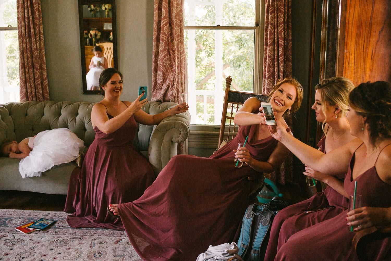 Bridesmaids sharing a joke as flower girl sleeps Barr Mansion Austin Wedding Photos-Philip Thomas