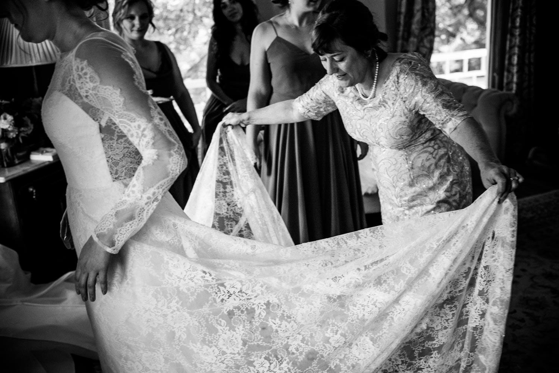 Mother of the bride fluffs brides dress Barr Mansion Austin Wedding Photos-Philip Thomas