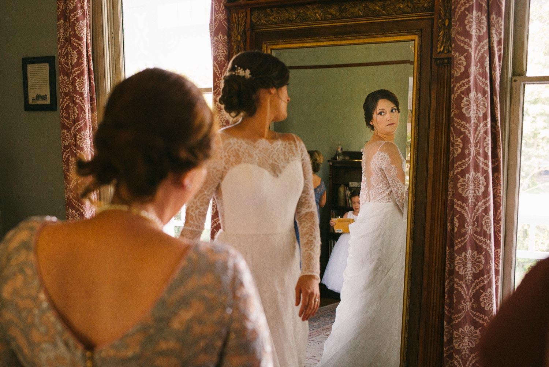 Bride checks mirror Barr Mansion Austin Wedding Photos-Philip Thomas