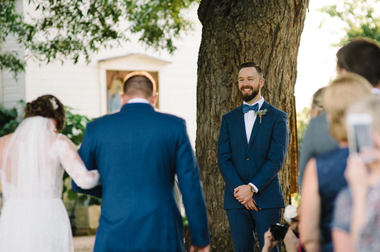 Bride with brother walk down the aisle Barr Mansion Austin Wedding Photos-Philip Thomas