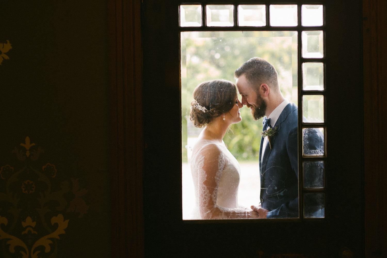 Couple on porch verandah Barr Mansion Austin Wedding Photos-Philip Thomas