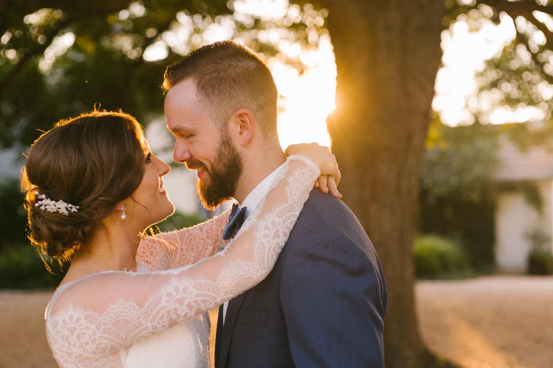 Married couple embrace at sunset Barr Mansion Austin Wedding Photos-Philip Thomas