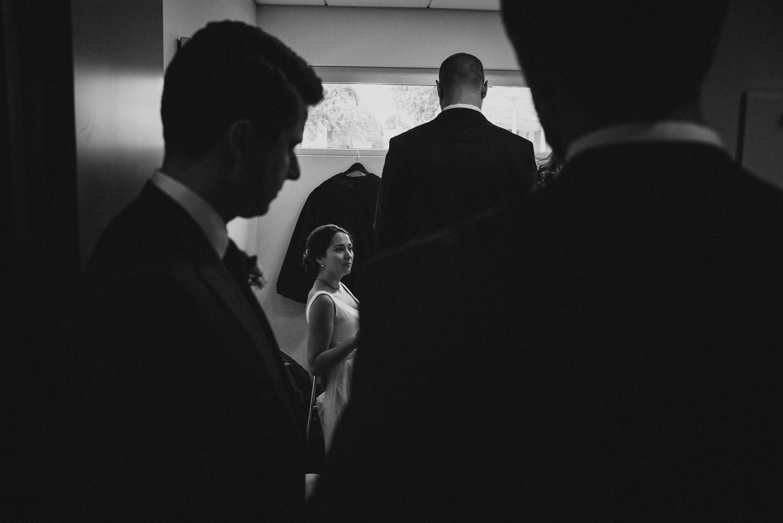Bride surrounded by groomsmen in the waiting room Cherie Flores Garden Pavilion Wedding Hermann Park Houston Texas-Philip Thomas