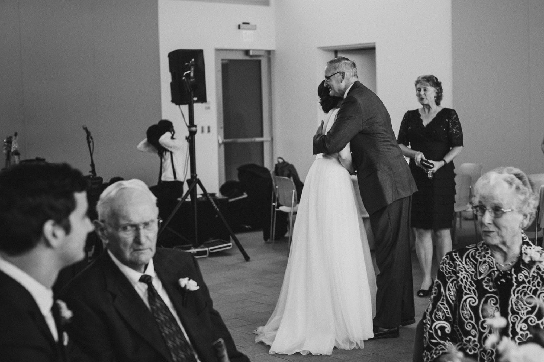 Family hugs between bride and family friend Cherie Flores Garden Pavilion Wedding Hermann Park Houston Texas-Philip Thomas
