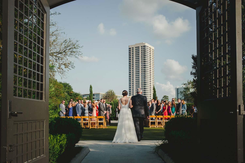 Bride and father walk down the aisle at Cherie Flores Garden Pavilion Wedding Hermann Park Houston Texas-Philip Thomas