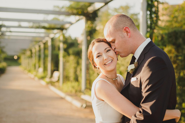 Groom kissed brides side of head beautiful bride at Cherie Flores Garden Pavilion Wedding Hermann Park Houston Texas-Philip Thomas