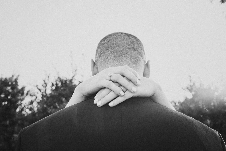 Wrapped hands round back of grooms head Cherie Flores Garden Pavilion Wedding Hermann Park Houston Texas-Philip Thomas