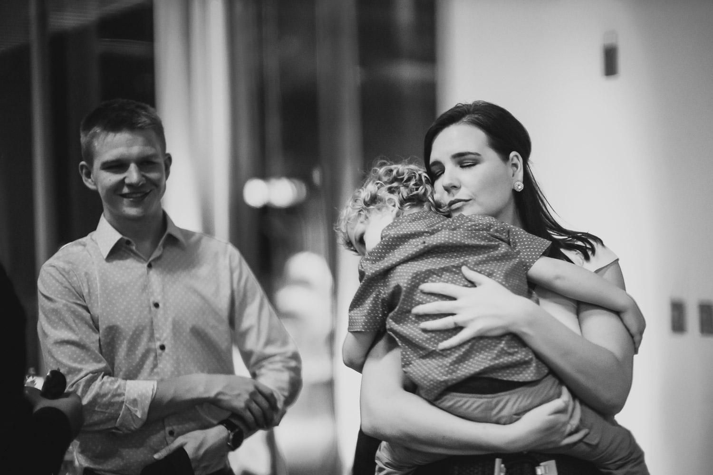 Mother holds tired toddler son Cherie Flores Garden Pavilion Wedding Hermann Park Houston Texas-Philip Thomas