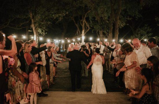 Back shot of couple leaving wedding reception