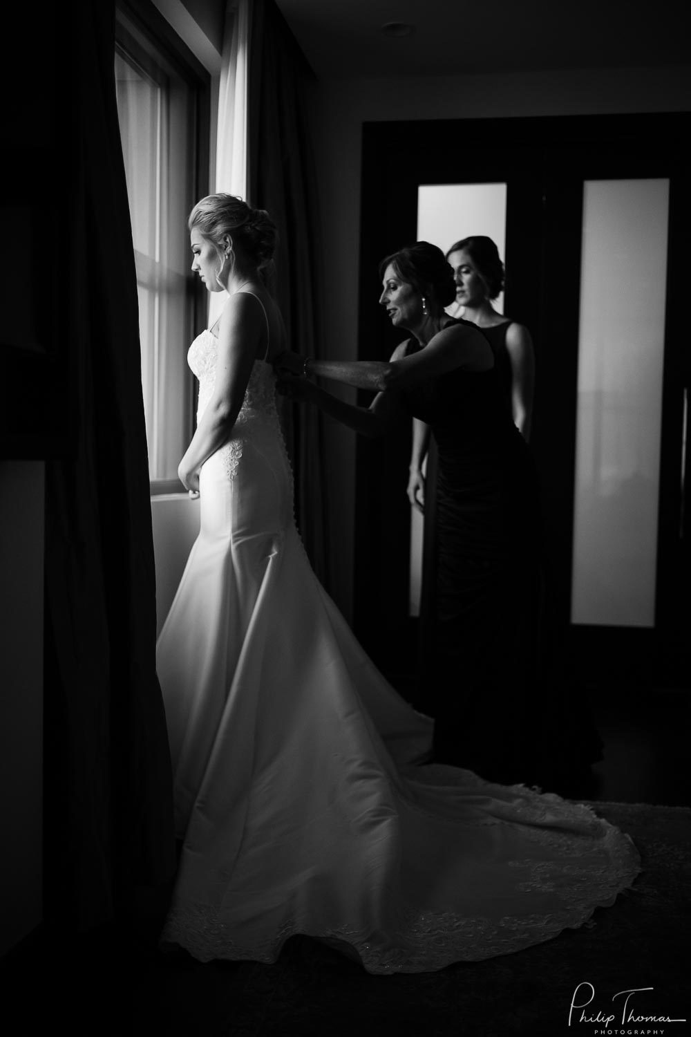 20-The JW Marriott Downtown Houston bride and groom get ready -Philip Thomas Photography