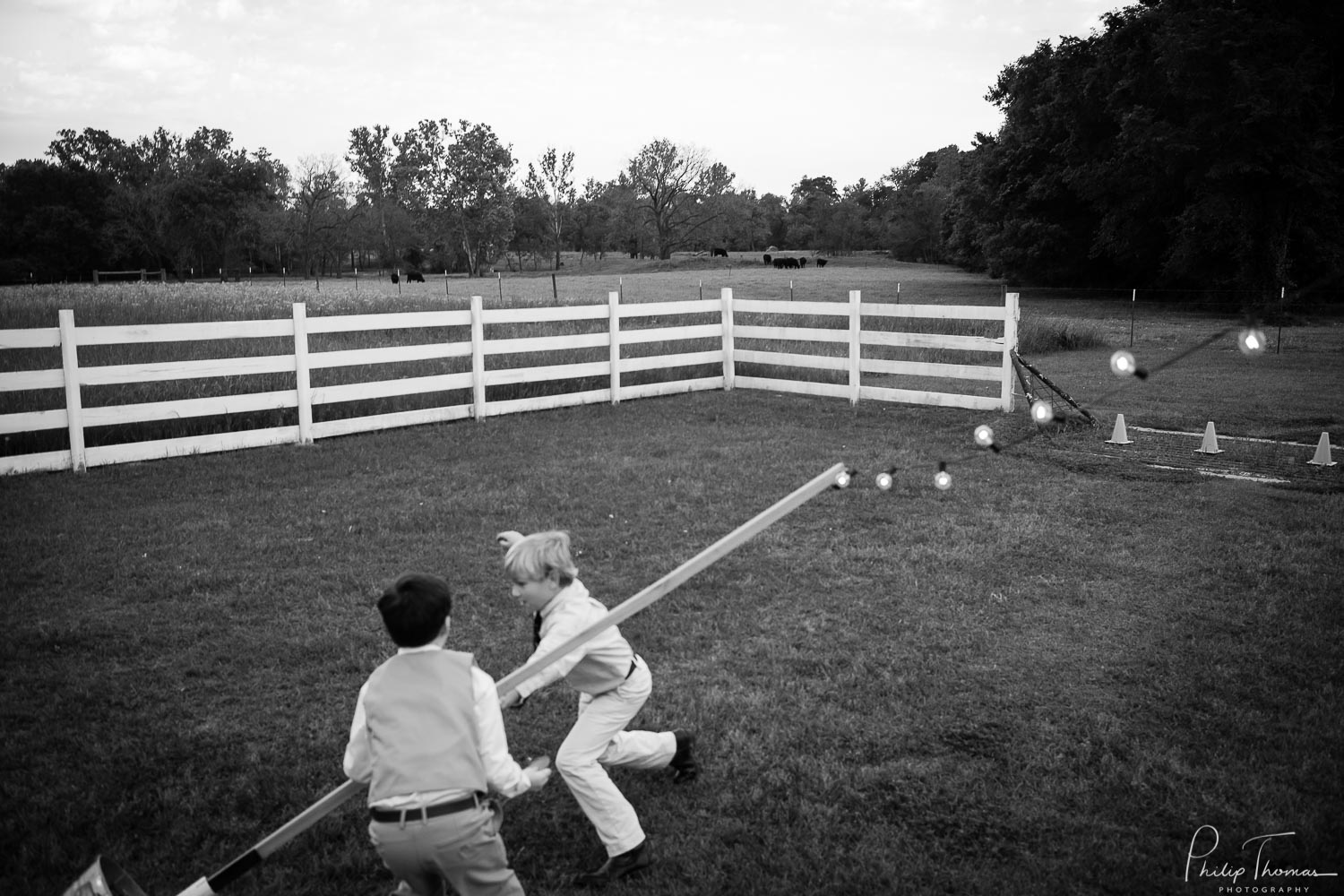 Kids play at back of the The Grand Texana Wedding Barr Minta + Phillip -