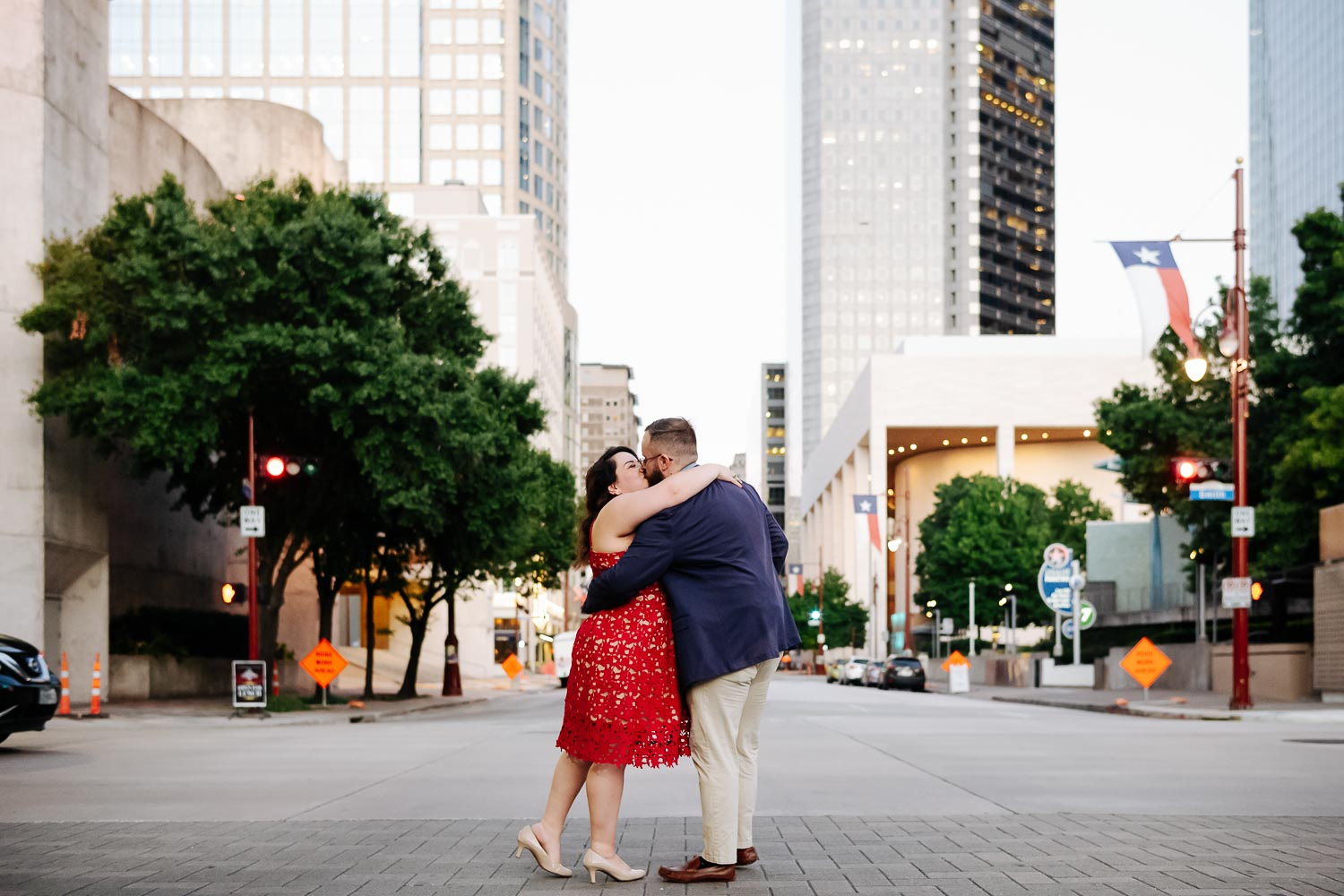 Crossing the street at Luci and Bryans engagement session downtown Theater District Houston Texas-Philip Thomas Photography
