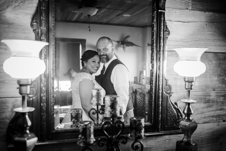 Couple pose in mirror -The-Venue-at-Rafter-E-Ranch-Leica-wedding