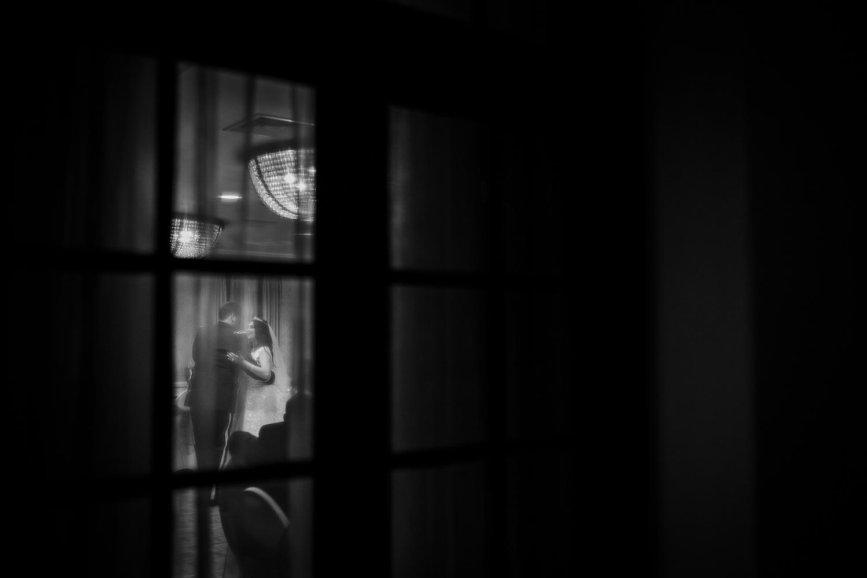 Last dance at Omni La Mansion Riverwalk hotel in San Antonio Texas shot through the window with curtains drawn