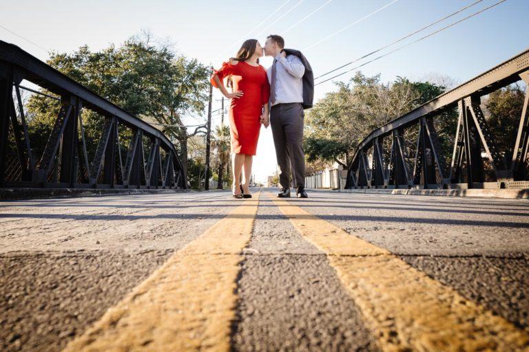 Beautiful engaged couple Arsenal Bridge over the San Antonio river kiss