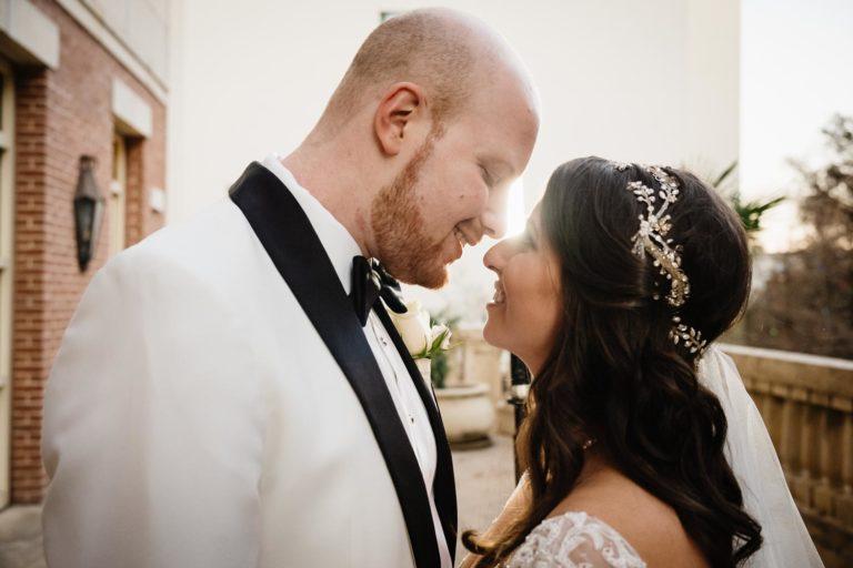 Couple Debra and Ryan on hotel balcony at Westin Riverwalk Hotel Jewish Wedding Ceremony Reception San Antonio Texas-Philip Thomas Photography